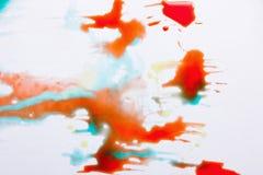 Abstract beeld van kleurrijke plonsen op wit Stock Afbeeldingen