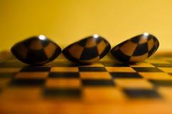 Abstract beeld van lepels op schaakraad Royalty-vrije Stock Foto's