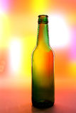 Abstract Beer Bottle Background. Abstract green beer bottle background design made from a beer bottle on a multi colored background Stock Photos