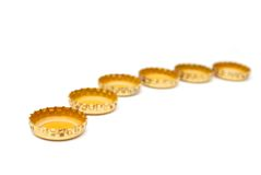 Abstract beer caps. Decoration with golden beer caps Royalty Free Stock Image