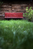 Abstract bench. A bench on a green meadow Royalty Free Stock Image