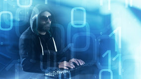 Abstract binary code background and hacker typing on keyboard. Computer hacker cyber crime concept royalty free stock photo