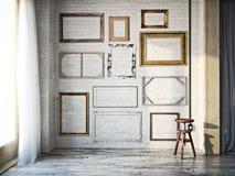 Abstract binnenland van geassorteerde klassieke lege omlijstingen tegen een witte bakstenen muur met rustieke hardhoutvloeren Stock Foto's