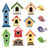 Abstract birdhouse set with birds Royalty Free Stock Photos