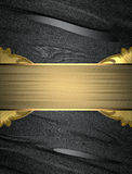 Abstract black background with an elegant gold plate. Template for design. copy space for ad brochure or announcement invitation Royalty Free Stock Photos