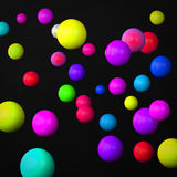 Abstract black background made of color spheres Stock Photography