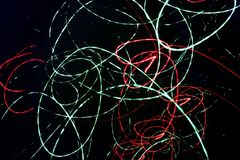 Abstract black background with neon chaotic spiral lines Stock Photo
