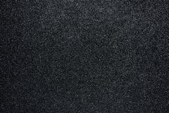 Black glitter sandpaper background with texture, Close-up royalty free stock images