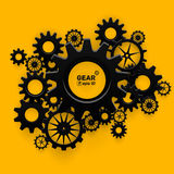 Abstract black gear wheels symbol on bright yellow Royalty Free Stock Photos