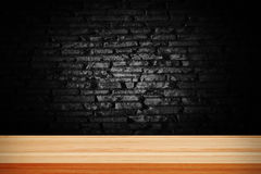 Abstract black grunge brick and wooden table deck. Stock Images