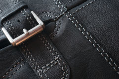 Abstract black leather background. With seams and buckle Royalty Free Stock Photos