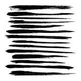 Abstract black long strokes of paint on a white backgr Royalty Free Stock Image