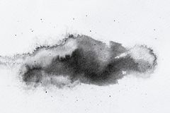 Abstract black splashes on white watercolor paper. monochrome image. Abstract black splashes on white watercolor paper. monochrome image Stock Photos