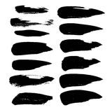 Abstract black strokes of paint on a white background Stock Images