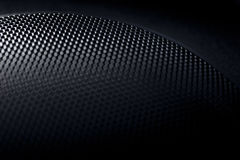 Abstract black textured background. Abstract macro photo of a black speaker grille Royalty Free Stock Photography