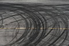 Abstract of Black tire wheels caused by Drift car on the road Royalty Free Stock Photos