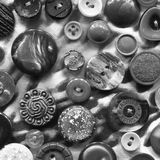 Abstract black and white background of buttons Stock Images