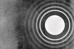 Abstract black and white background with circles rings pattern and grunge texture Royalty Free Stock Image