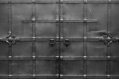 Steel black gates. Symmetrical and . Abstract black and white background with correct geometric proportions Royalty Free Stock Images