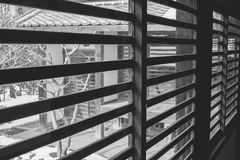 Abstract black and white image of architecture interior of wooden window blind inside the Kawagoe Castle. royalty free stock photos
