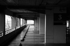 Abstract Black and White image rows of empty space car parking lot. Stock Photos