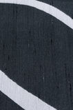 Abstract black and white pattern. Close up of black dupion textile with white curves Royalty Free Stock Photo