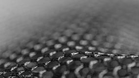 Abstract black and white texture from netting. Artistic detail of hexagonal grid with bokeh in HD 16x9 ratio. Concept for science, research, technology and Royalty Free Stock Photography
