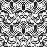 Abstract black and white vintage seamless pattern. Vector monochrome ornamental background. Decorative hand drawn floral line art tracery ornament. Paisley Stock Photos