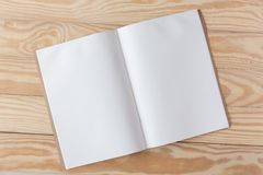 Abstract Blank one white paper on wooden table top view background concept for empty letter business sheet, plain brochure mock up. Template, flyer card royalty free stock photo