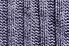 Abstract blauw het breien textuurclose-up Stock Afbeeldingen