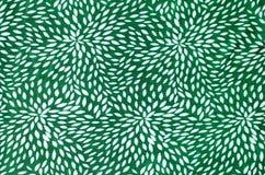 Abstract bloemenpatroon op groene stof Royalty-vrije Stock Foto's