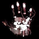 Abstract bloody hand-print. On a black background Stock Photos