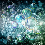 Abstract blue background with bokeh and bubbles. Green and light Royalty Free Stock Images