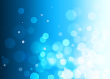 Abstract blue background with bokeh effect, gradient, circles. Festive blue bokeh background with free space Stock Images