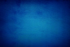 Abstract blue background or dark paper with bright center spotli Royalty Free Stock Photo