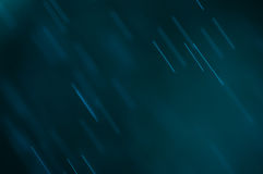 Abstract blue background, falling water drops Stock Photography