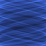 Abstract blue background pattern. Bright blue lines on the dark blue background. Stock Images