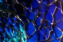 Abstract blue background - small glass, artistic glass processing. Beautiful deep color close to indigo. Creative glass cracks stock photography