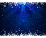 Abstract blue background with snowflakes and stars Stock Images
