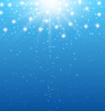 Abstract blue background with sunbeams and shiny stars Stock Photo