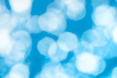 Abstract  blue background with white shapes. Abstract blue background with white blurred shapes in the form of an octahedron Stock Images