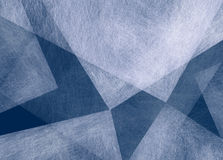 Abstract blue background with white triangle shapes with texture in random pattern Stock Images