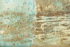 Abstract blue, beige and turquoise background wallpaper texture. Old flaky paint peeling off grungy cracked wall. Cracks, scrapes. Peeling old paint and royalty free stock photos