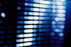 Abstract blue blur of city lighting digital lens flare glare, blinds light background. Abstract blue blur of city lighting digital lens flare glare, blinds light royalty free stock photography
