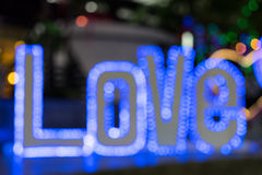 Abstract blue bokeh as word LOVE Royalty Free Stock Images