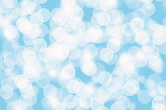 Abstract blue Bokeh circles for Christmas background. Glitter light Defocused and Blurred Bokeh Stock Photo