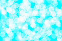 Abstract blue Bokeh circles for Christmas background. Glitter light Defocused and Blurred Bokeh Stock Image