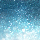 Abstract blue bokeh lights, defocused background of blue and white lights. royalty free stock photography