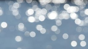 Abstract blue bokeh shiny water background stock footage