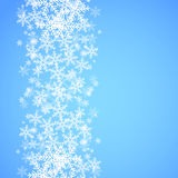 Abstract blue Christmas background with snowflakes. Stock Photos